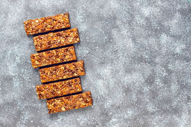 Healthy delicios granola bars with chocolate and muesli bars with nuts and dry fruits