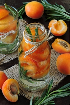 Healthy detox drink apricot with rosemary.