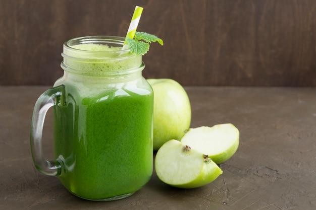 Healthy detox green smoothie in a mason jar.
