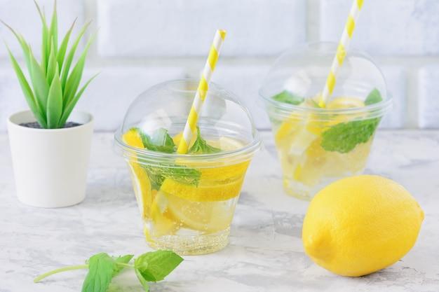 Healthy detox water with lemon slice fresh mint
