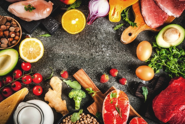 Colorful fruits and vegetables on plank background Photo ...