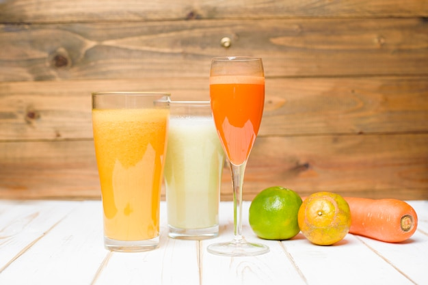 Healthy diet fruits and vegetables juice ready to drink on wooden table