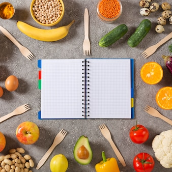 Healthy diet plan healthy lifestyle concept. notepad with a schedule of food and healthy food