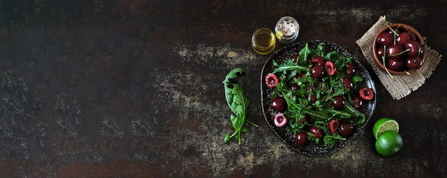 Healthy dietary salad with sweet cherries and arugula. fitness salad. raw diet.
