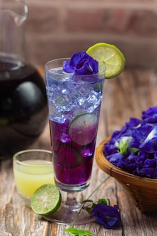 Healthy drink, organic blue pea flower tea with lemon and lime.