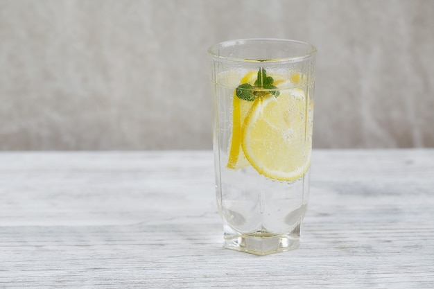 Healthy drinks.  lemonade with fresh lemon on wooden table
