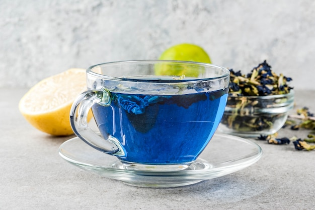Healthy drinks, organic blue butterfly pea flower tea with limes and lemons