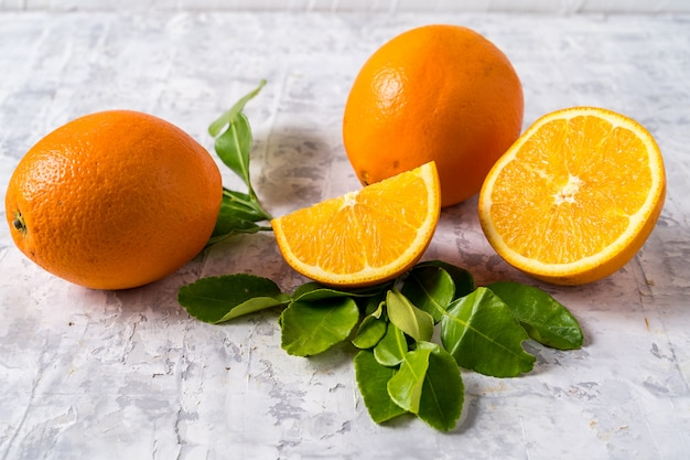Healthy eating concept. flat lay of raw fresh orange fruit on gray background and copy space.