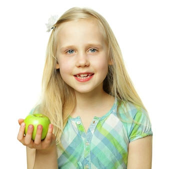 Healthy eating concept, smiling child girl holding green apple, beautiful face closeup