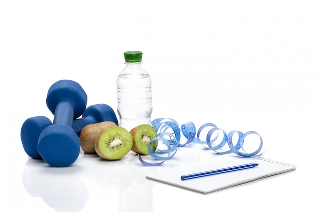 Healthy eating, diet and  detox . dumbbells, kiwi  water