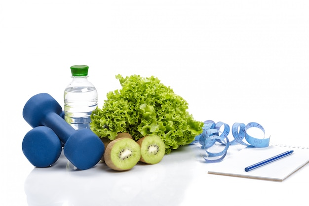 Healthy eating, diet and  detox . dumbbells, kiwi and water