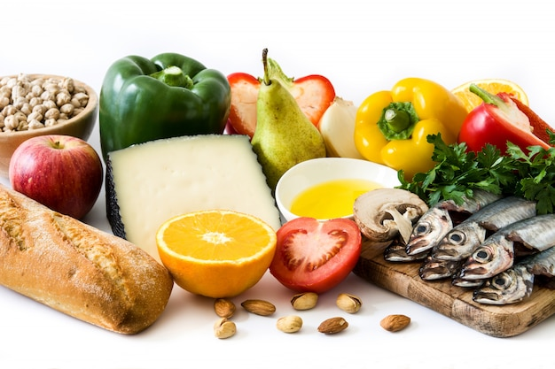 Healthy eating mediterranean diet fruit,vegetables, grain, nuts olive oil and fish on white