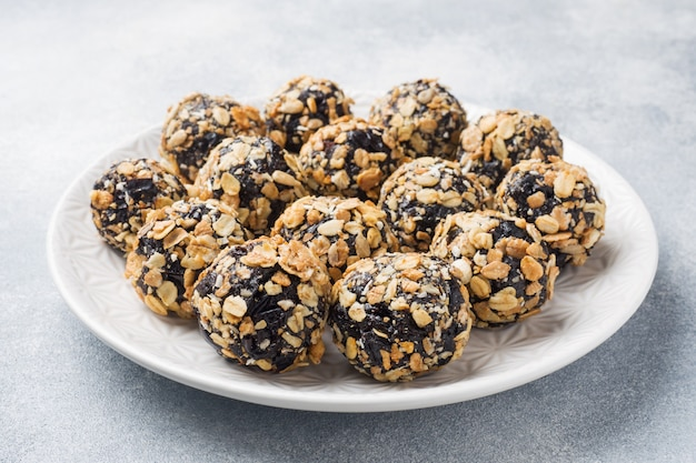 Healthy energy balls made of dried fruits and nuts with oatmeal and muesli