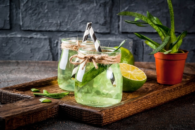 Healthy exotic detox drink, aloe vera or cactus juice with lime
