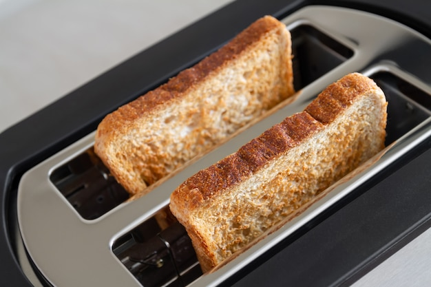 Healthy fashion food of breakfast. toast in a toaster.