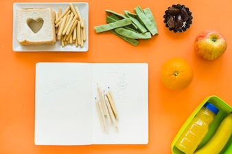 Healthy food around opened notebook