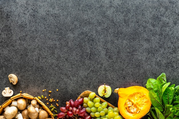 Healthy food background. autumn fresh vegetables on dark stone table with copy space, top view