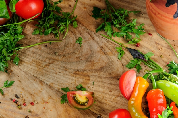 Healthy food background studio photography of different fruits and vegetables on old wooden table