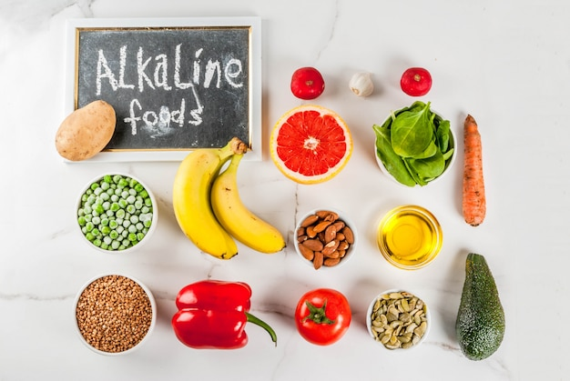Healthy food background, trendy alkaline diet products - fruits, vegetables, cereals, nuts. oils above