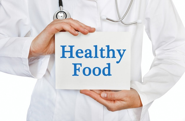 Healthy food card in hands of medical doctor