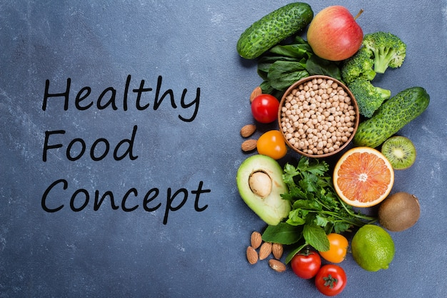 Healthy food clean concept. raw fruits, vegetables, nuts, cereals on concrete stone table background