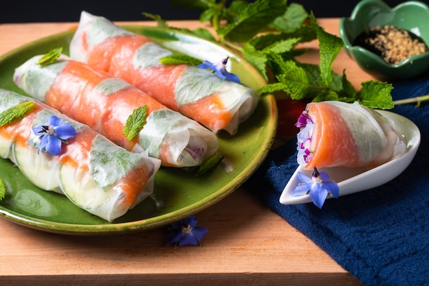 Healthy food concept fresh smoked salmon rice paper spring rolls with colorful vegetable with copy space
