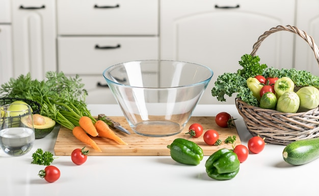 Healthy food concept. fresh vegetables on a white table on a cutting board in the kitchen.