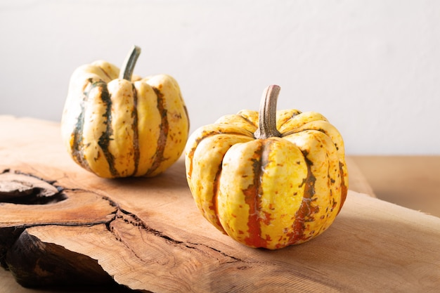Healthy food concept organic sweet dumpling squash pumpkin on wood