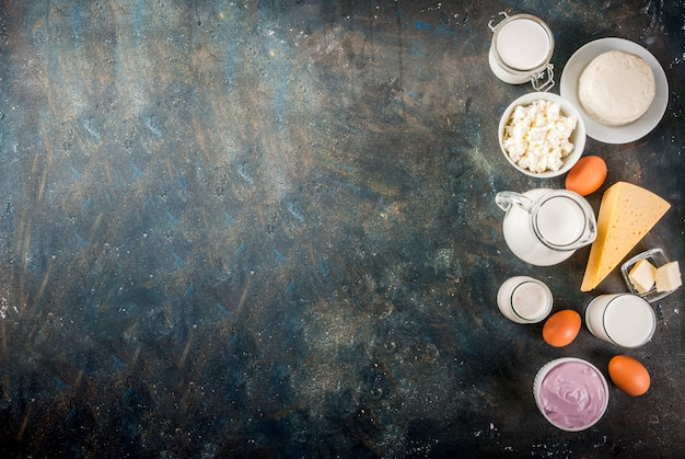 Healthy food concept. set of dairy products dark blue surface copy space top view background