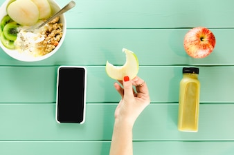 Healthy food concept with hand holding apple slice