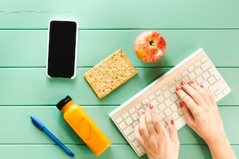 Healthy food concept with hands typing on keyboard