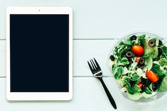 Healthy food concept with tablet