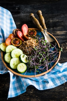 Healthy food concept with vegetables and buckwheat