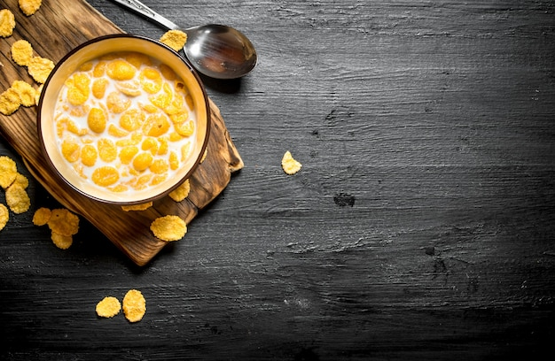 Healthy food. cornflakes with milk on wooden board.