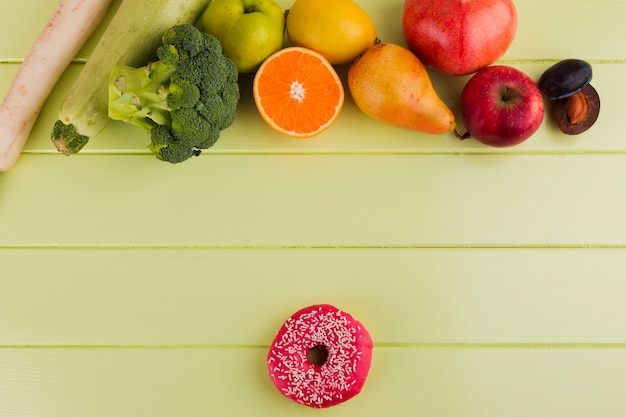 Healthy food and a doughnut