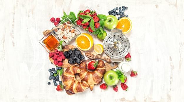 Healthy food drink breakfast table croissants fresh berries fruits
