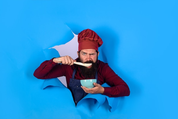 Healthy food eat healthy healthy ration chef wear hat and apron looking through paper hole man