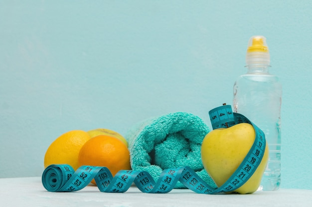 Healthy food, fruit, towel and water in a bottle