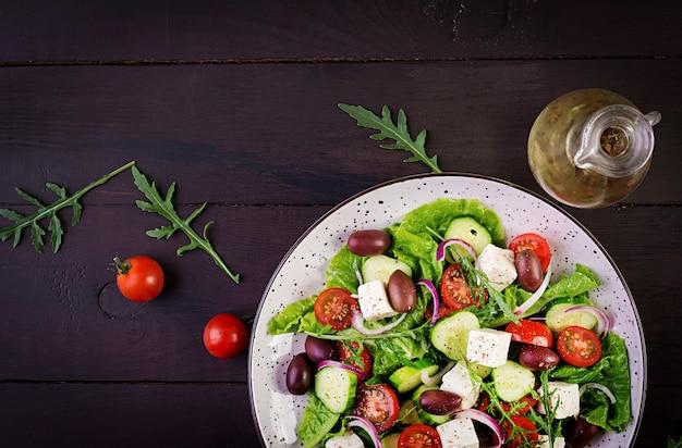 Healthy food. greek salad with fresh vegetables