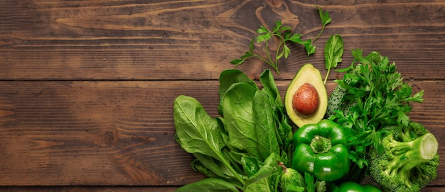 Healthy food green vegetable on wooden background top view