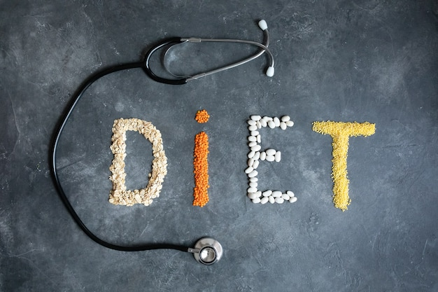 Healthy food for heart diet abstract . nutritionist offers healthy diet. healthy lifestyle. healthy food in heart and cardiograph on blackboard medical abstract .