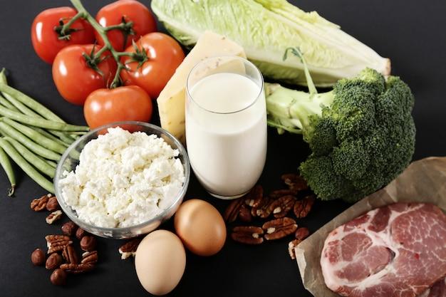 Healthy food ingredients on black table