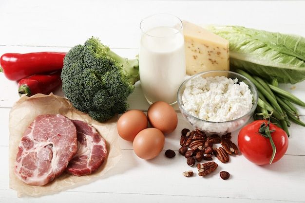 Healthy food ingredients on white wooden table