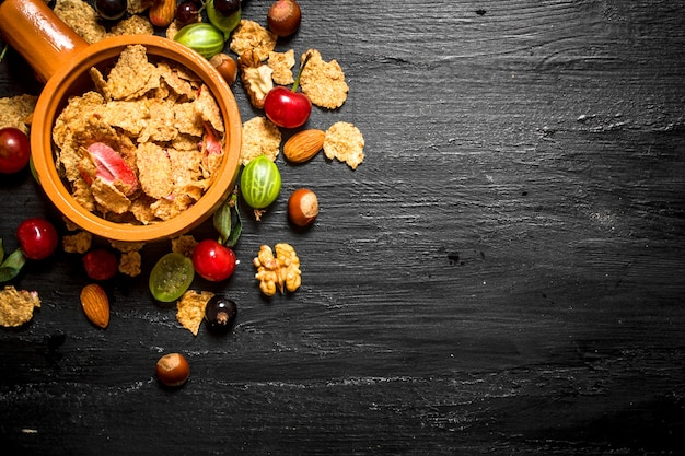 Healthy food. muesli with forest berries. on a black wooden table.