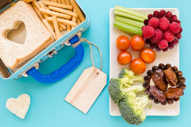 Healthy food near labelled lunchbox