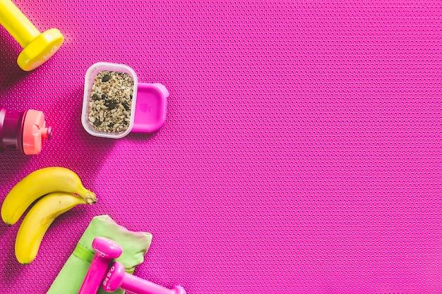 Healthy food near sports equipment