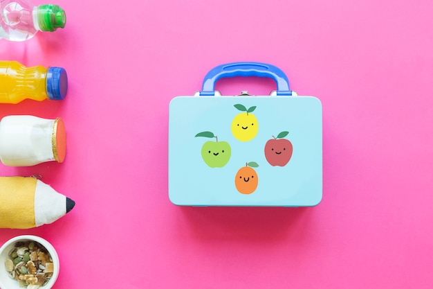 Healthy food and pencil case near lunchbox