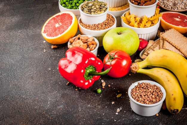 Healthy food surface, trendy alkaline diet products - fruits, vegetables, cereals, nuts.