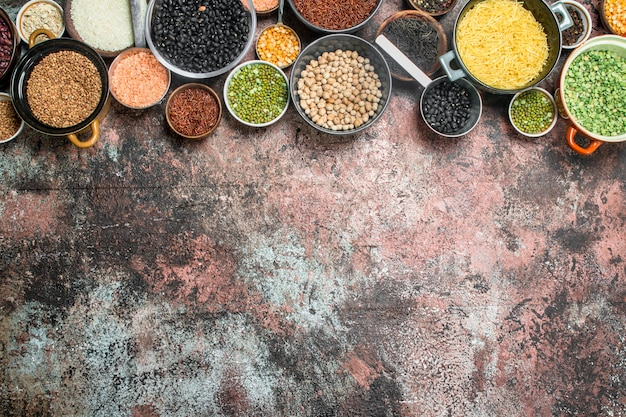 Healthy food. variety of assortment of legumes in bowl. on a rustic background.
