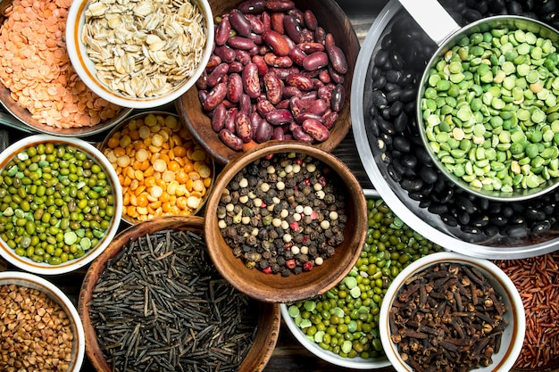 Healthy food. variety of legumes on wooden table.